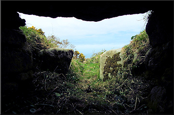 Inside Treen South chambered cairn, looking out